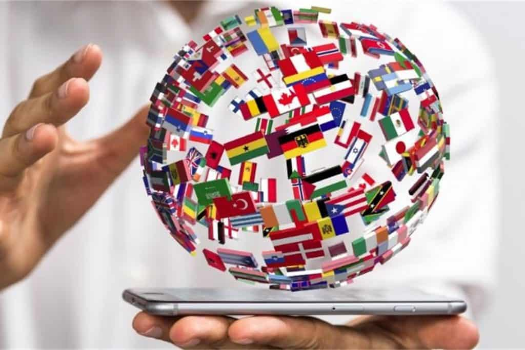 A globe with various country flags